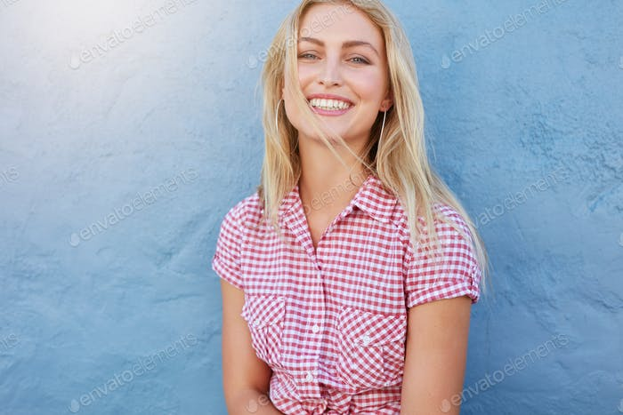 Cheerful young woman looking at camera and smiling