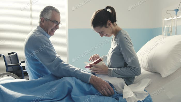Father visiting her daughter at the hospital