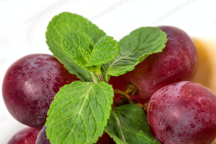 Closeup of delicious red grapes and mint.