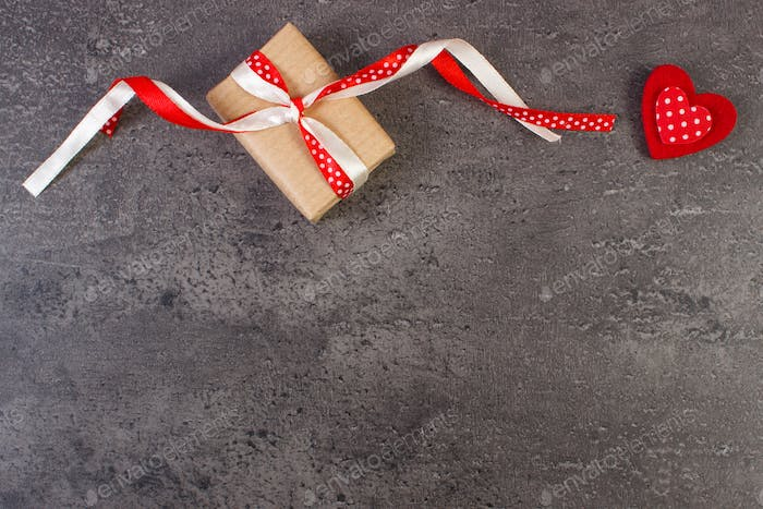Wrapped gift and red heart for Valentines Day, copy space for text