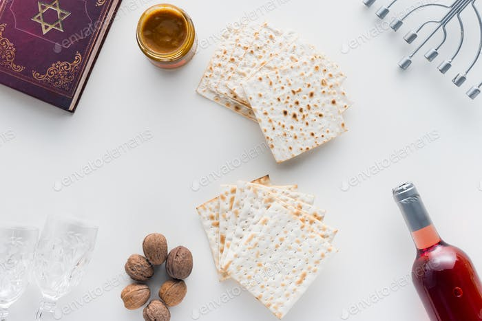 top view of matza and torah on white surface, Pesah celebration concept