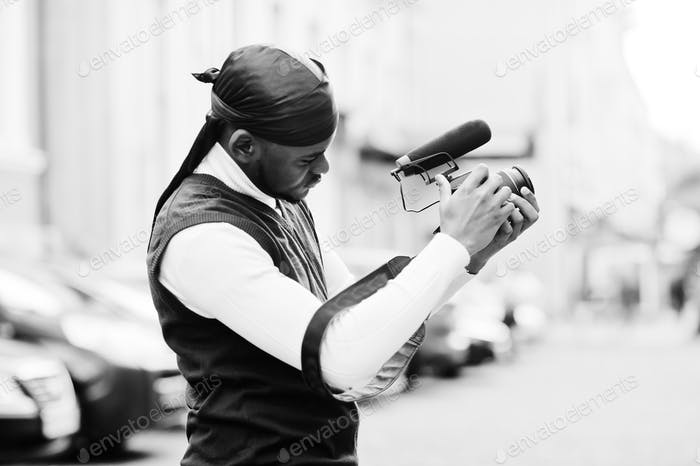 Young professional african american videographer