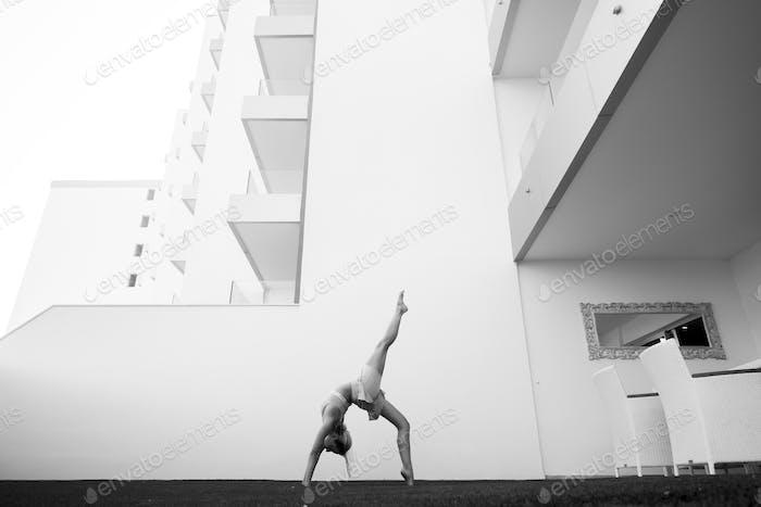 black and white image fine art representing beautiful girl doing balance pilates