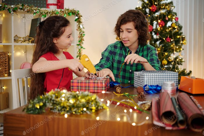 Siblings wrapping presents