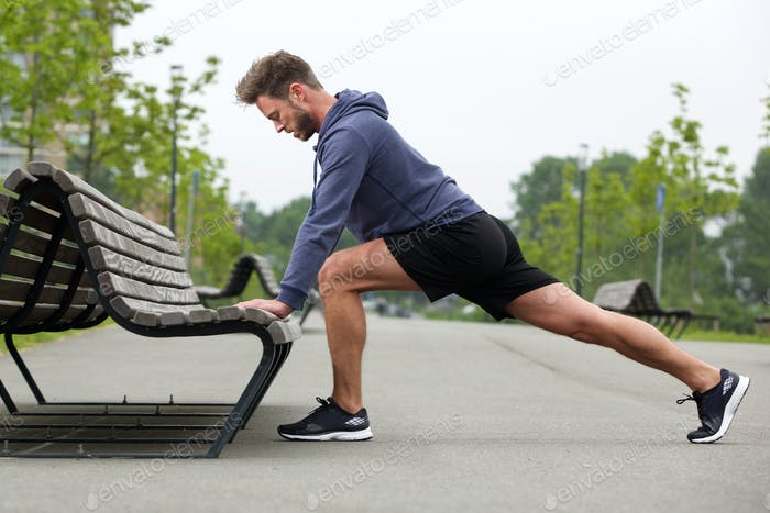 Healthy man doing stretch before jog