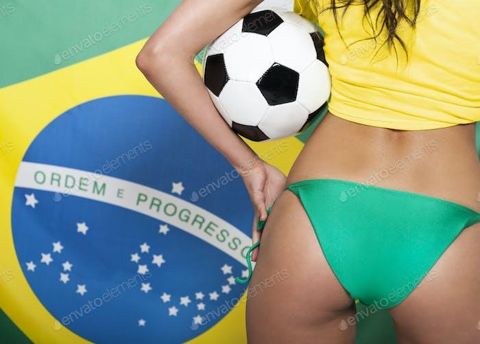 Sexy brazilian girl with soccer ball