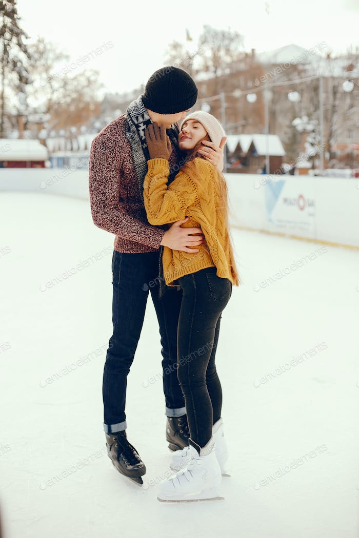 Cute couple in a ice arena