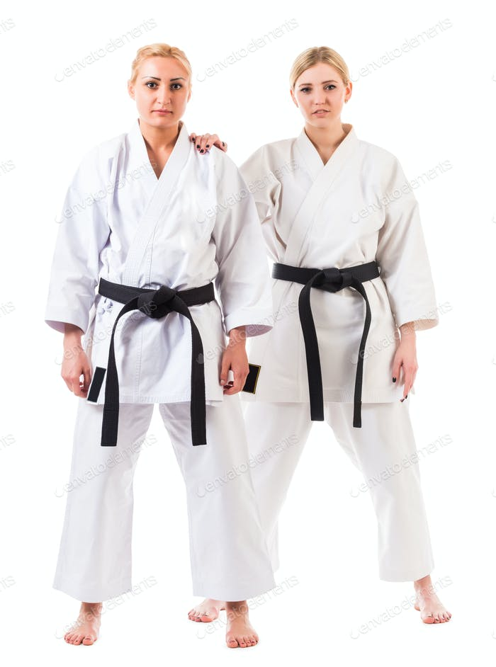 Girls athletes in karate kimono with black belts