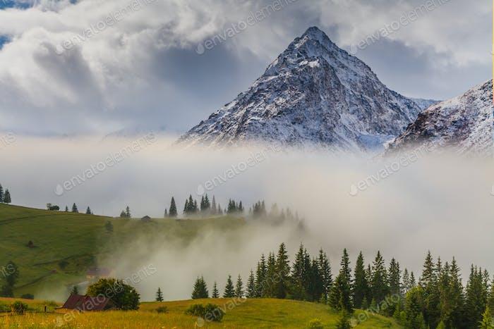 Beautiful mountain landscape in the misty sunrise. Alps, Austria
