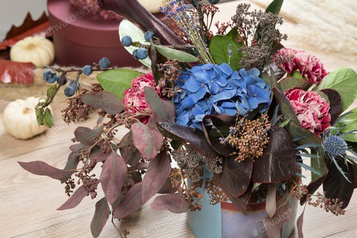 Beautiful autumn bouquet composition of dried meadow flowers and leaves