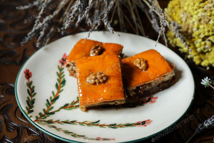 front view sochi baklava with walnuts on a plate