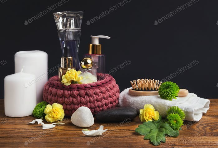 Beautiful spa composition with candles over grey background