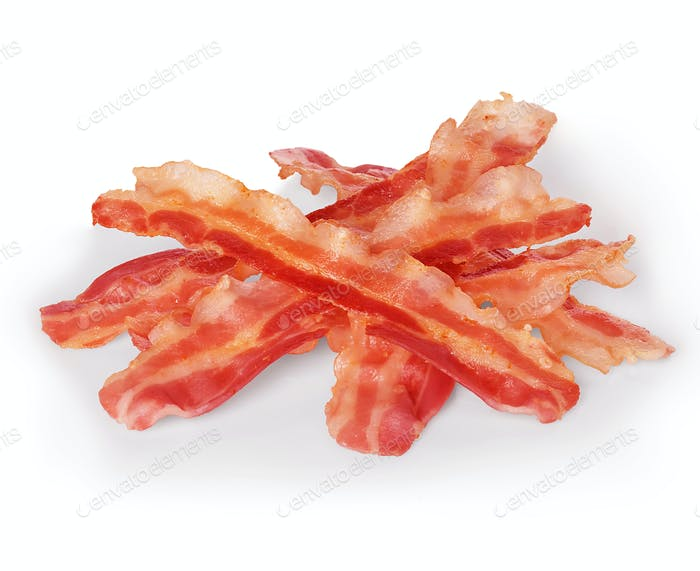 Strips of fried bacon closeup isolated on a white background. Classic american style.