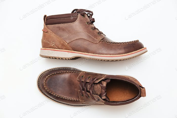A brown leather man shoes isolated white. Top view