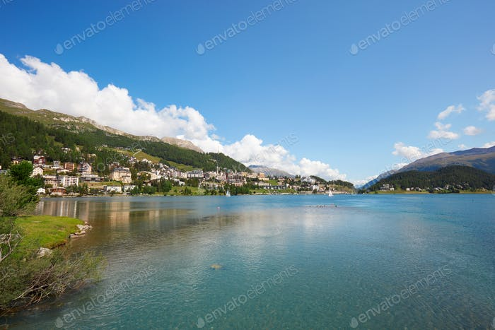 Sankt Moritz town and lake with transparent water