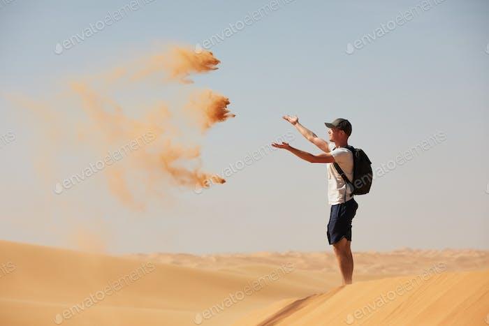 Happy traveler in desert