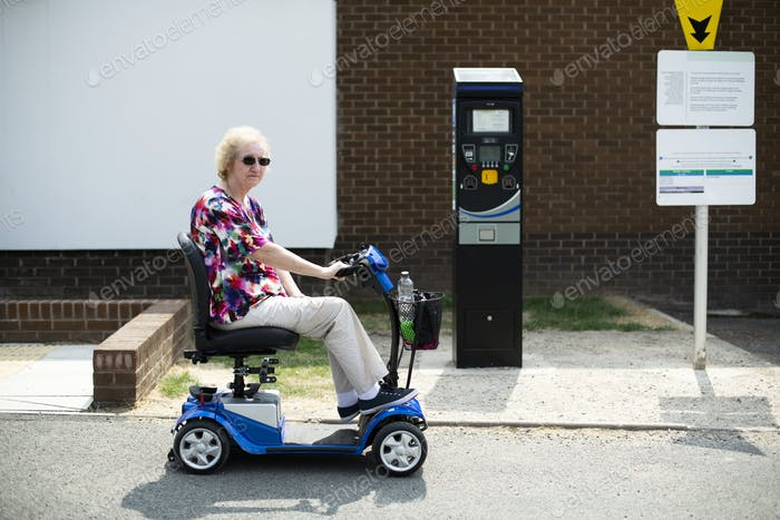 Senior woman on an electric wheelchair