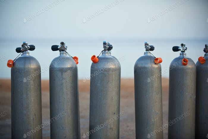 Collection of grey scuba diving air oxygen tanks.