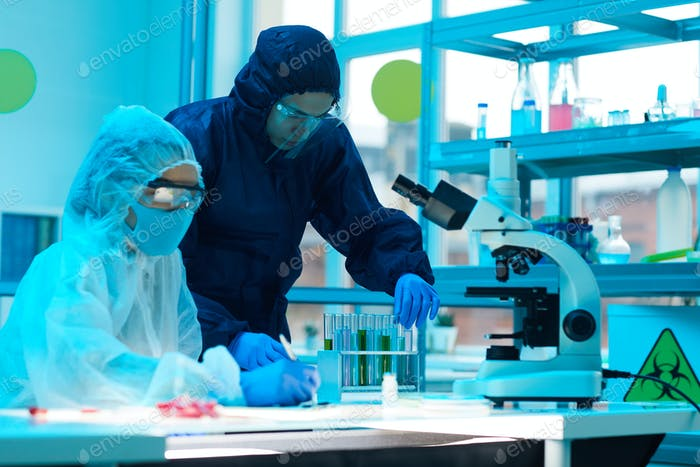 Scientists Wearing Hazmat Suits in Laboratory