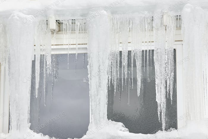 Icicle windows on winter time. Freeze temperatures backgrounds. Horizontal