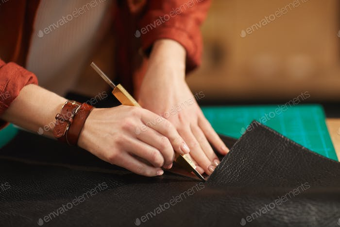 Artisan Cutting Out Leather