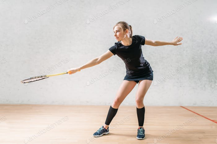 Squash game training, female player with racket