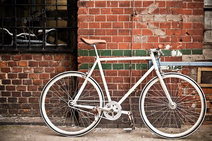 City bicycle on red wall, vintage style