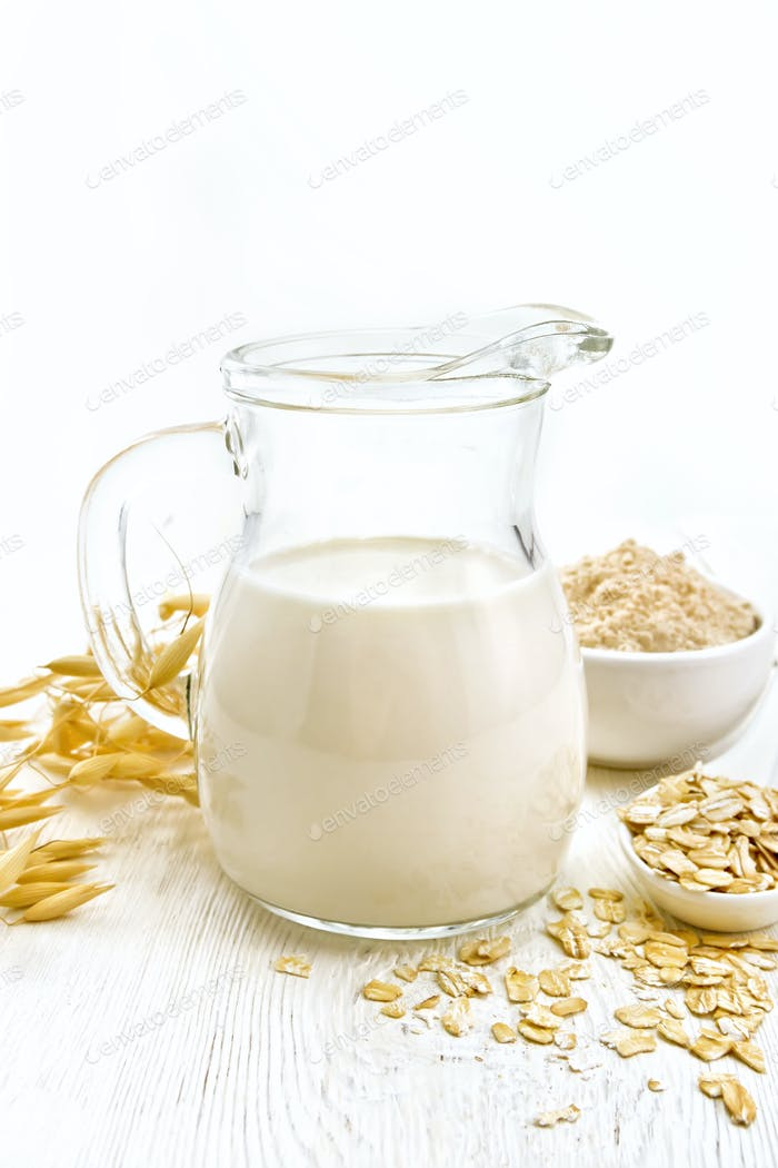 Milk oatmeal in jug on light board
