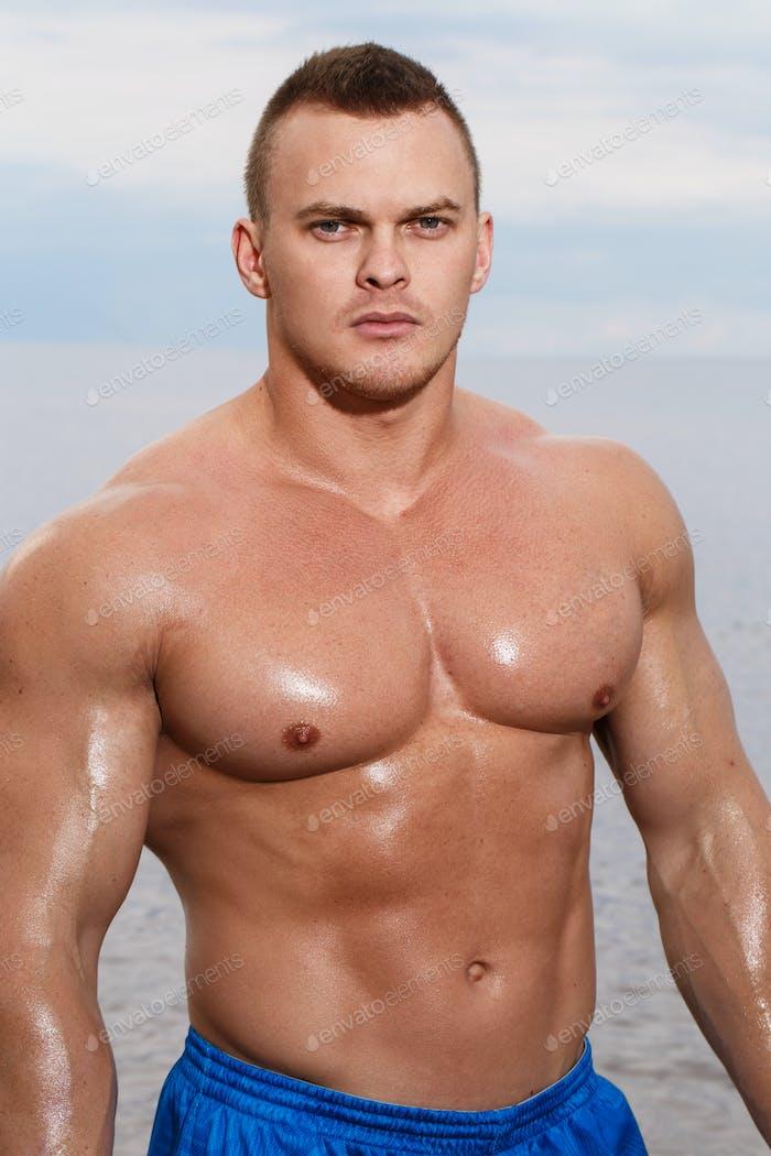 Sexy bodybuilder on the beach