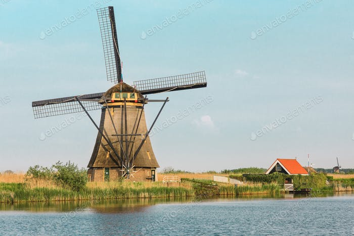 Traditional Dutch windmills with green grass in the foreground, The Netherlands