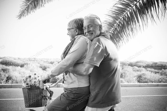 elderly senior caucasian couple play and enjoy leisure activity outdoor in lifestyle vacation