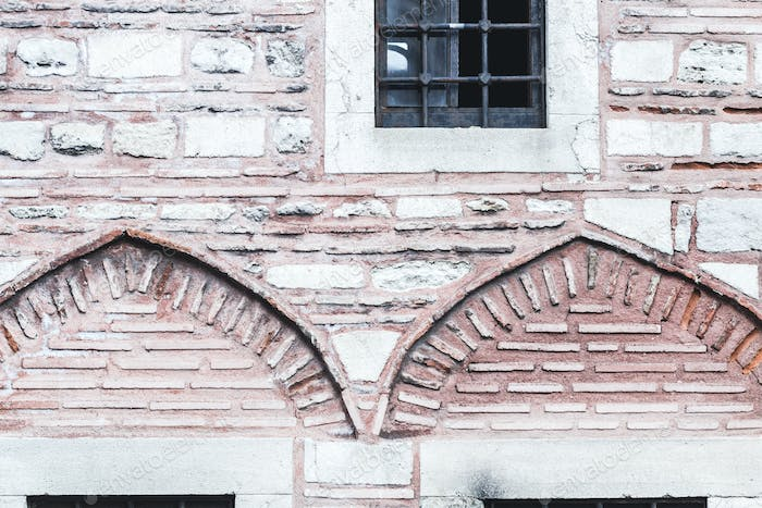 Beautiful stone and bricks facades with different sizes windows in Turkey Istanbul