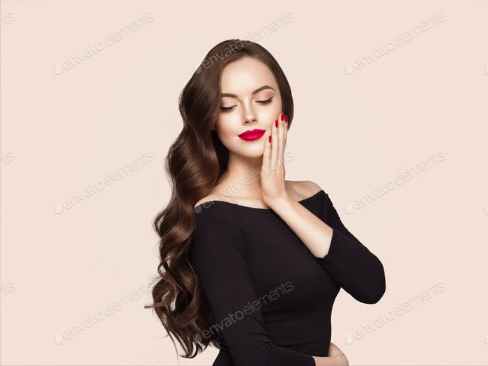 Beautiful hair woman with long brunette hair beauty healthy hairstyle. Beige background. With hands.