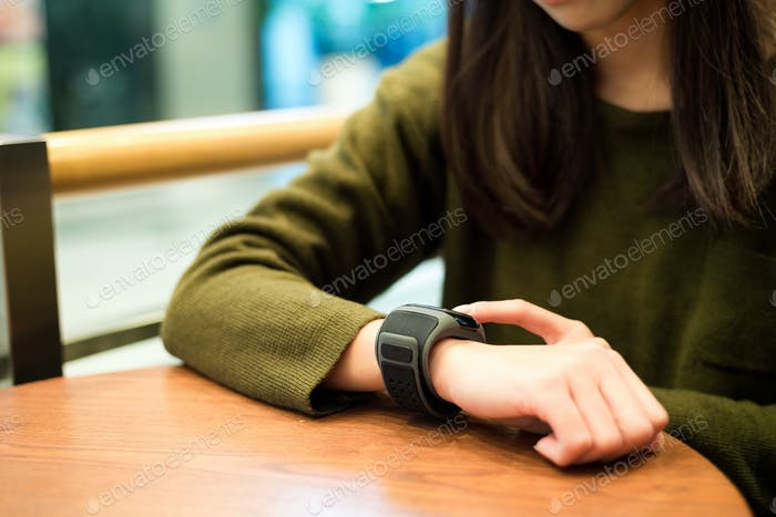 Woman touch on the smart watch