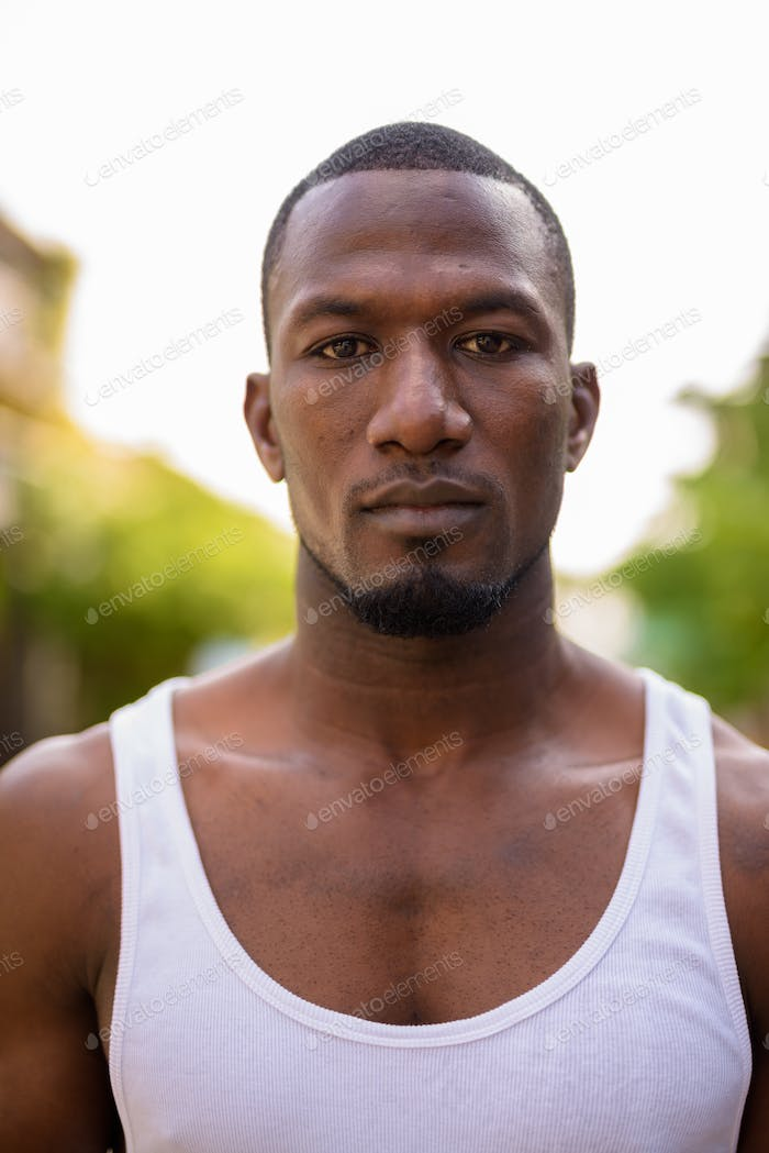 Handsome muscular African man in the streets outdoors