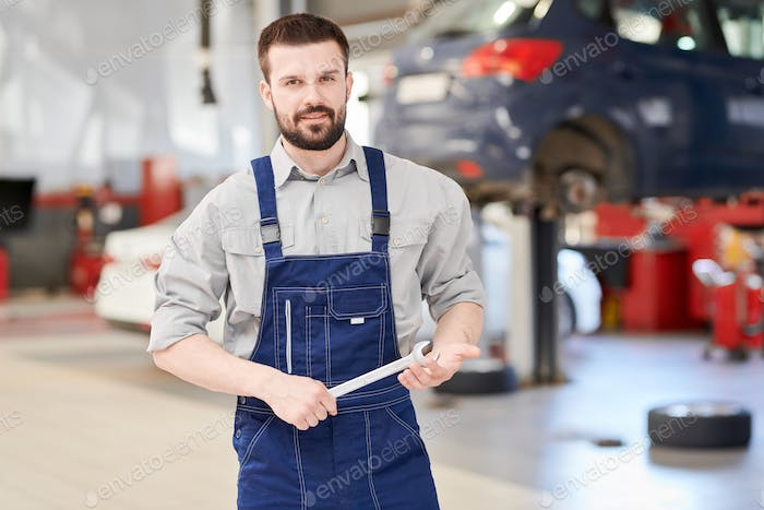 Car Mechanic Posing in Workshop