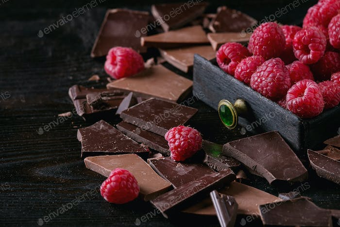 Variety of chopping chocolate with raspberries