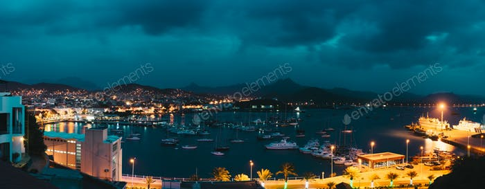 Cape Verde, Sao Vicente Island. Twilight panoramic view of Mindelo city port town with many boats in
