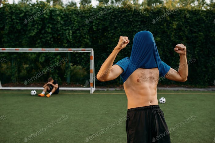 Male soccer player hits the goal on the field