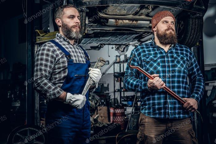 Two mechanics in a garage.