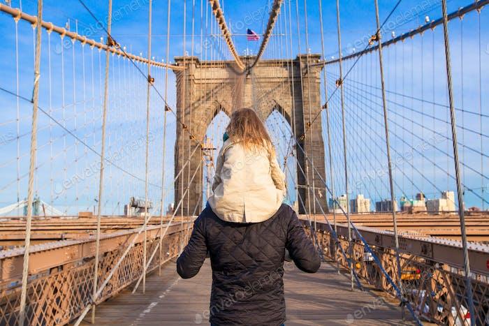Dad and little girl on Brooklyn bridge, New York City, USA