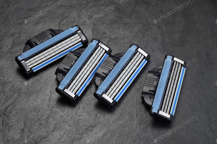 Razor blades refills on black slate background