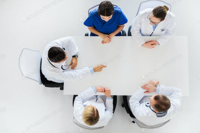 doctor showing something imaginary on table