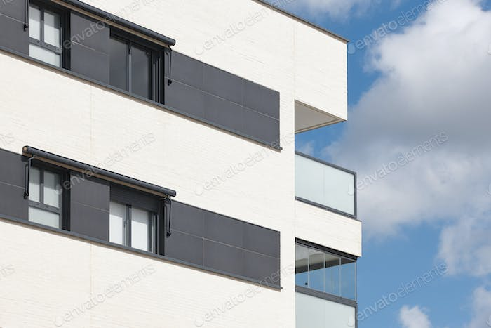 New building exterior facade with terrace. Construction. Buy, rent
