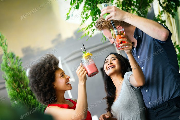 Young friends having a great time together. Group of people talking and smiling