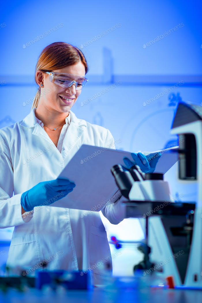 Biotechnology. Portrait of female scientist in laboratory