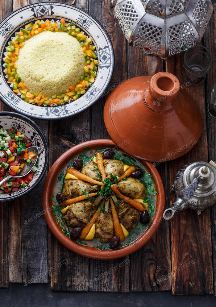 Morrocan party food tajine, salad, couscous, tea, top view.
