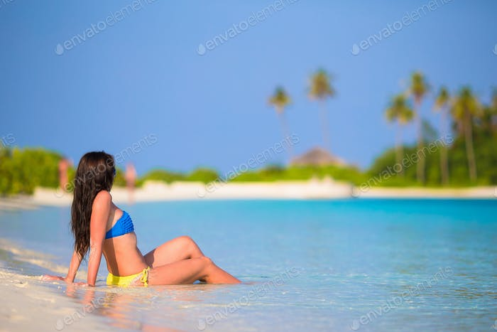 Young woman enjoy tropical beach vacation