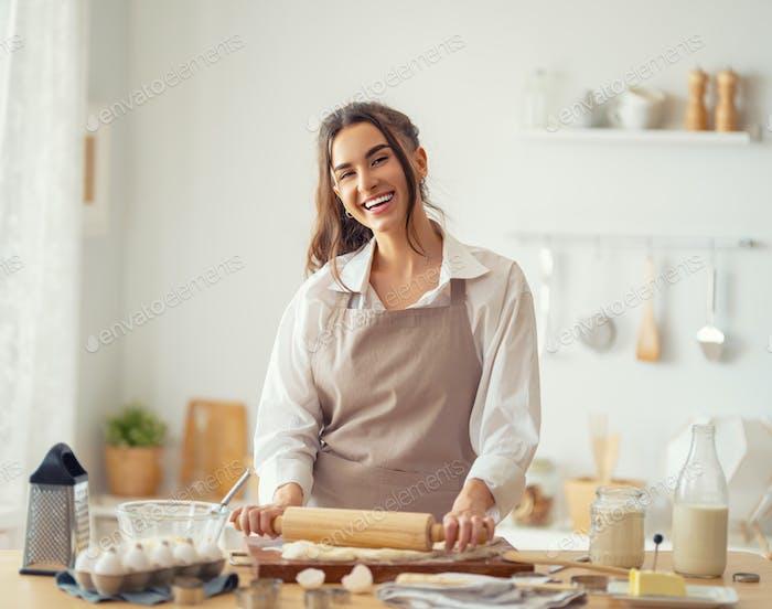 woman is preparing bakery.