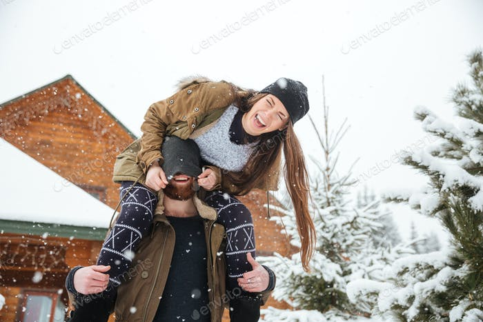 Couple having fun and laughing in winter